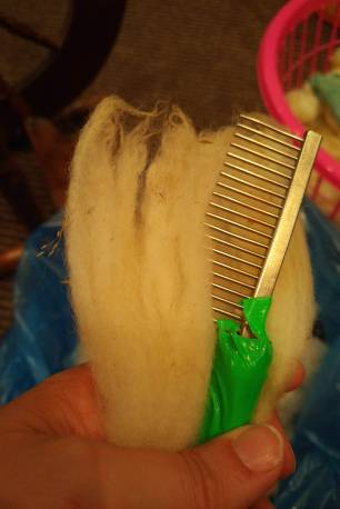 A metal toothed pet comb works through long locks easily.